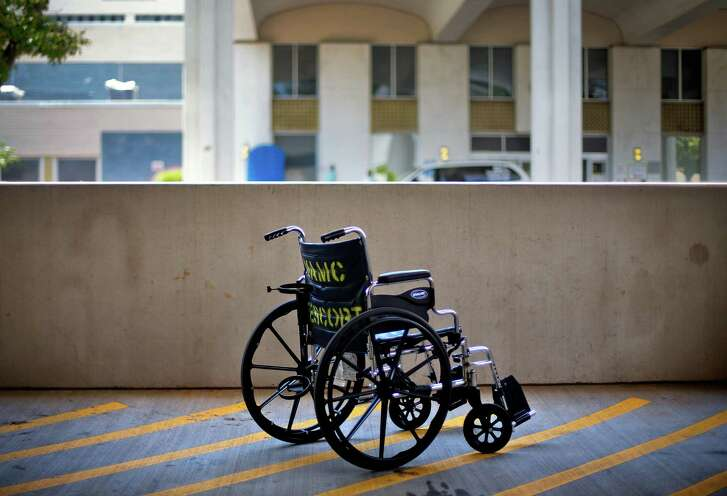FILE - In this May 24, 2013 file photo, a wheelchair sits outside the Atlanta VA Medical Center in Atlanta. An internal investigation released in June 2014 that looked at wait times for all sorts of care across the VA system showed that new mental health patients were routinely forced to wait a month or more to start treatment. Not one of the 141 medical systems examined was able to meet the department's goal of getting all new mental health patients an appointment within 14 days. (AP Photo/David Goldman, File)