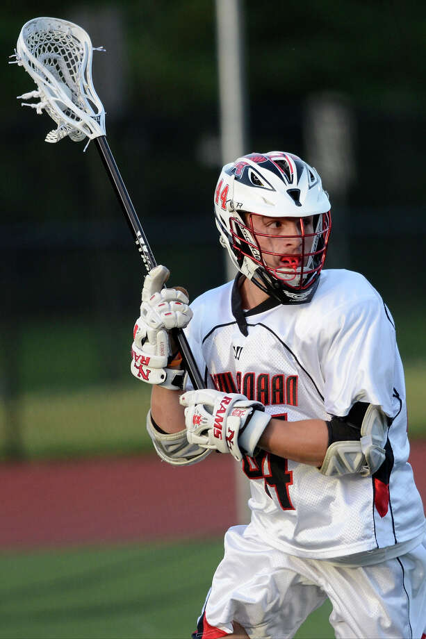 New Canaan's #44 Teddy Bossidy looks to pass as New Canaan High School challenges Joel Barlow High School in Class M semifinal boys lacrosse at Fairfield Ludlowe High School in Fairfield, CT on Weds., June 11, 2014. Photo: Shelley Cryan / Connecticut Post freelance/Shelley Cryan
