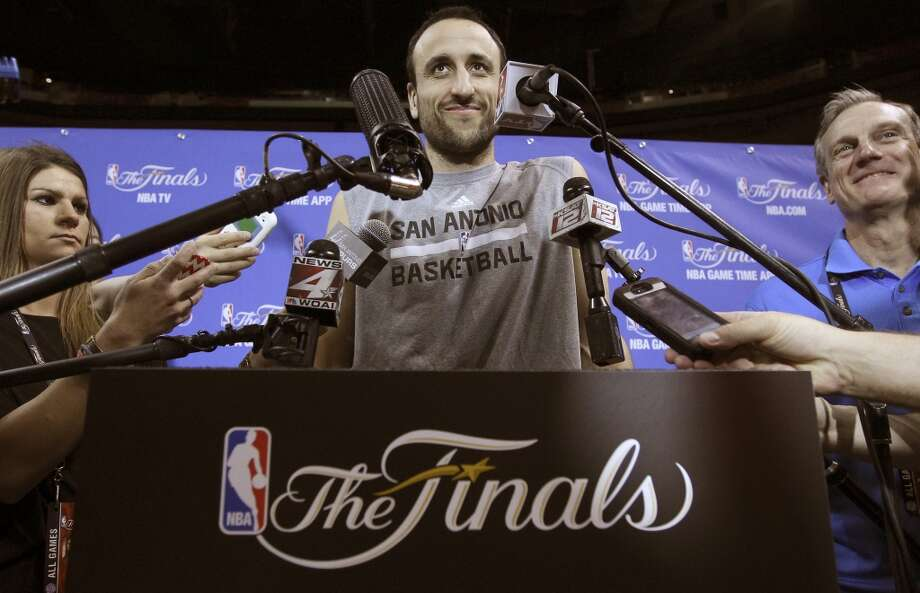 Spurs' Manu Ginobili (20) smiles while answering questions from the media during practice and media sessions at the American Airlines Arena in Miami on Wednesday, June 11, 2014. (Kin Man Hui/San Antonio Express-News) Photo: San Antonio Express-News
