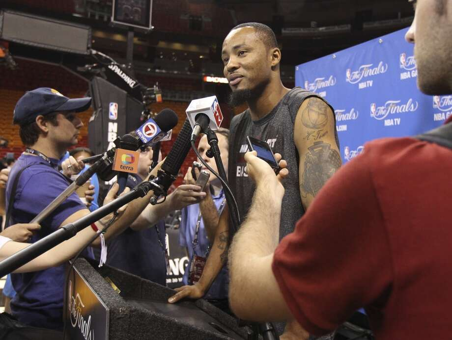 Miami Heat's Rashard Lewis (09) takes questions from the media during practice and media sessions at the American Airlines Arena in Miami on Wednesday, June 11, 2014. (Kin Man Hui/San Antonio Express-News) Photo: San Antonio Express-News
