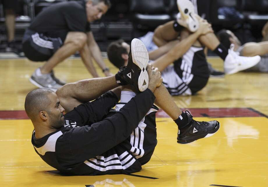 Spurs' Tony Parker (09) stretches during practice and media sessions at the American Airlines Arena in Miami on Wednesday, June 11, 2014. (Kin Man Hui/San Antonio Express-News) Photo: San Antonio Express-News