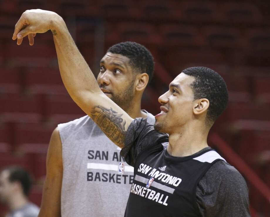 Spurs' Tim Duncan (21) watches a free throw attempt by teammate Danny Green during practice and media sessions at the American Airlines Arena in Miami on Wednesday, June 11, 2014. (Kin Man Hui/San Antonio Express-News) Photo: San Antonio Express-News