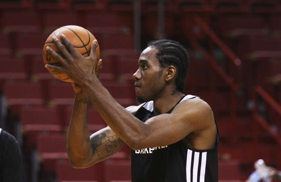 Spurs' Kawhi Leonard (02) takes a free throw during practice and media sessions at the American Airlines Arena in Miami on Wednesday, June 11, 2014. (Kin Man Hui/San Antonio Express-News) Photo: San Antonio Express-News