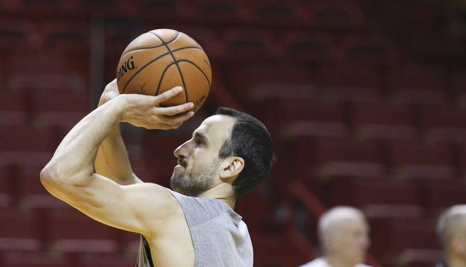 Spurs' Manu Ginobili (20) takes a free throw during practice and media sessions at the American Airlines Arena in Miami on Wednesday, June 11, 2014. (Kin Man Hui/San Antonio Express-News) Photo: San Antonio Express-News