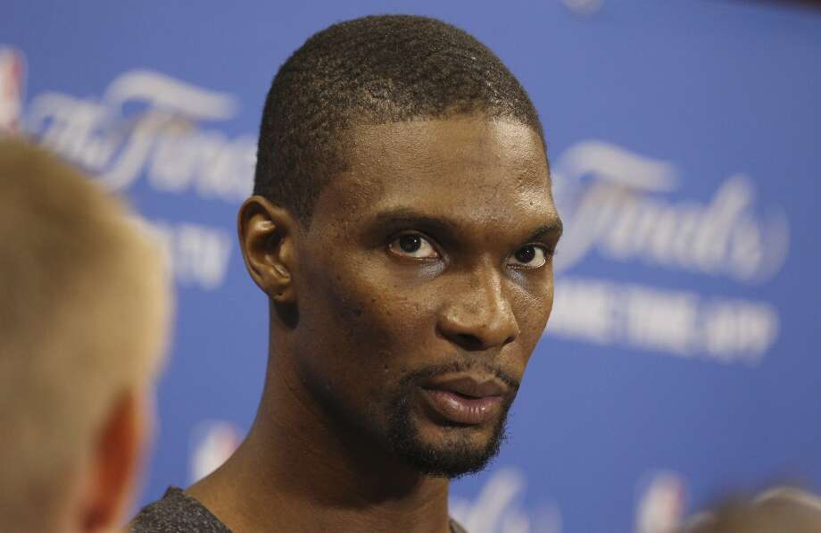 Miami Heat's Chris Bosh (01) listens to reporters' questions during practice and media sessions at the American Airlines Arena in Miami on Wednesday, June 11, 2014. (Kin Man Hui/San Antonio Express-News) Photo: San Antonio Express-News