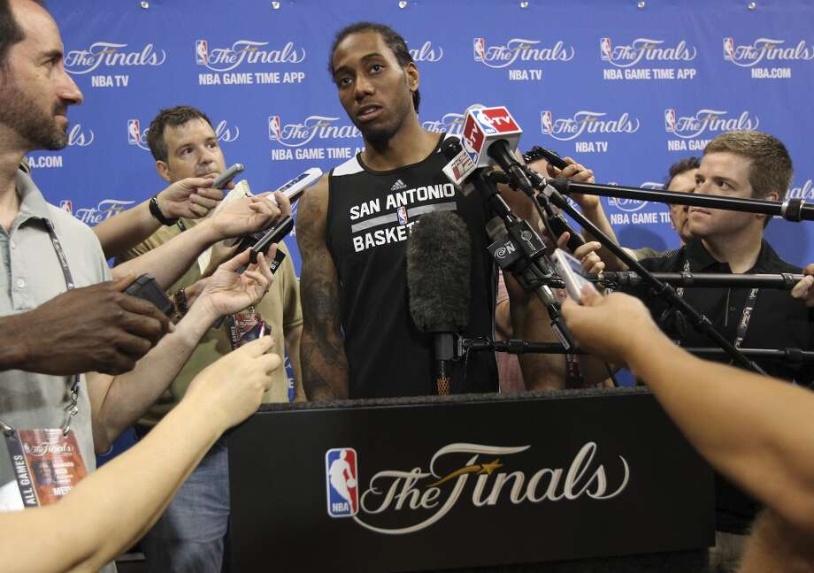 Spurs' Kawhi Leonard (02) takes questions from the media during practice and media sessions at the American Airlines Arena in Miami on Wednesday, June 11, 2014. (Kin Man Hui/San Antonio Express-News) Photo: San Antonio Express-News