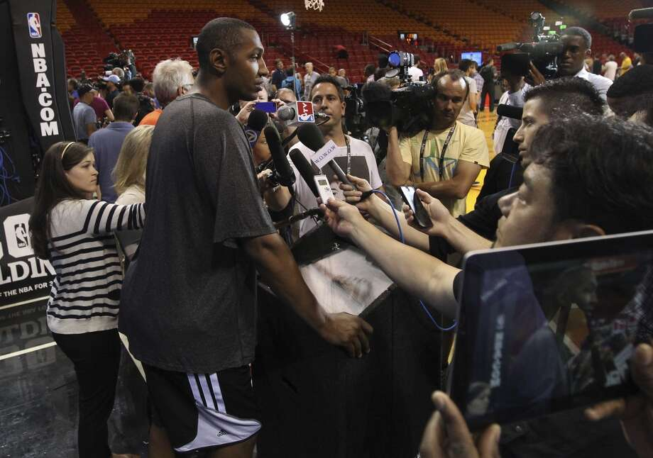 Spurs' Boris Diaw (33) takes questions from the media during practice and media sessions at the American Airlines Arena in Miami on Wednesday, June 11, 2014. (Kin Man Hui/San Antonio Express-News) Photo: San Antonio Express-News