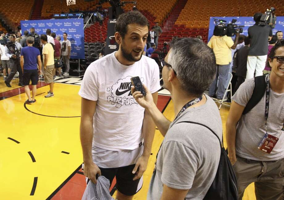 Spurs' Marco Belinelli (03) answers questions from the media during practice and media sessions at the American Airlines Arena in Miami on Wednesday, June 11, 2014. (Kin Man Hui/San Antonio Express-News) Photo: San Antonio Express-News