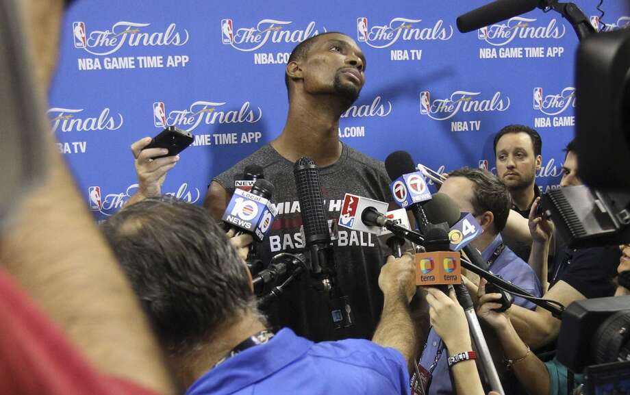 Miami Heat's Chris Bosh (01) listens to reporters ask questions during practice and media sessions at the American Airlines Arena in Miami on Wednesday, June 11, 2014. (Kin Man Hui/San Antonio Express-News) Photo: San Antonio Express-News