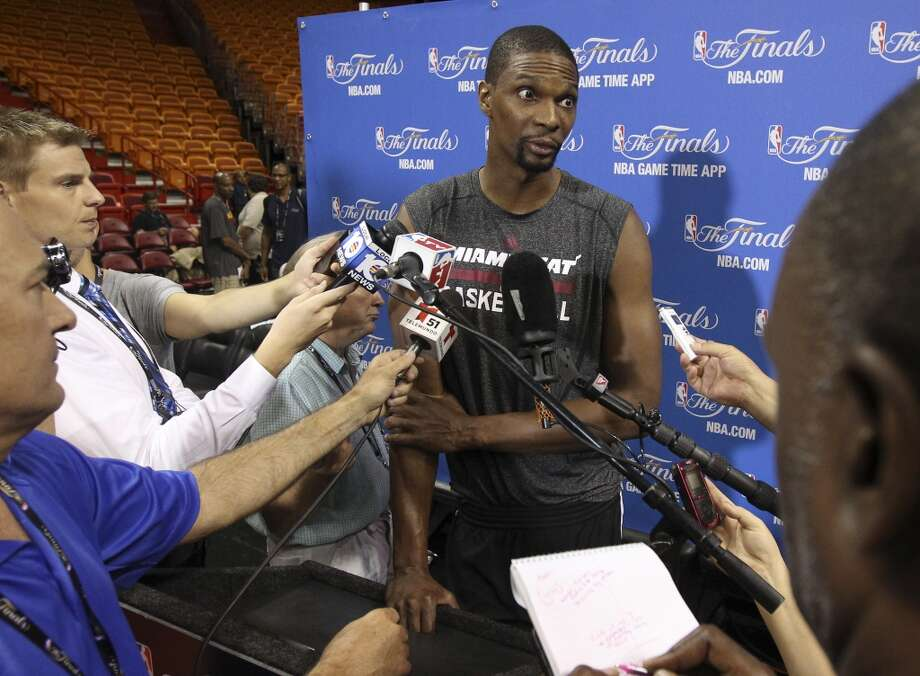 Miami Heat's Chris Bosh (01) answers questions from the media during practice and media sessions at the American Airlines Arena in Miami on Wednesday, June 11, 2014. (Kin Man Hui/San Antonio Express-News) Photo: San Antonio Express-News