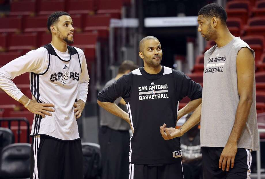 San Antonio Spurs' Austin Daye (from left), Tony Parker, and Tim Duncan talk during practice Wednesday June 11, 2014 at American Airlines Arena in Miami, Fla. Photo: San Antonio Express-News