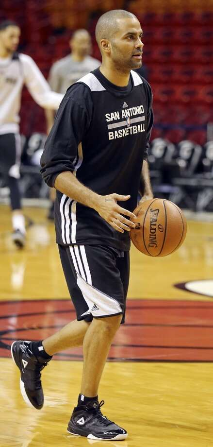 San Antonio Spurs' Tony Parker runs drills during practice Wednesday June 11, 2014 at American Airlines Arena in Miami, Fla. Photo: San Antonio Express-News