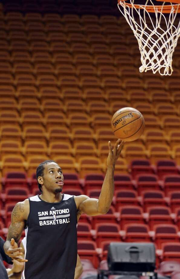 San Antonio Spurs' Kawhi Leonard runs drills during practice Wednesday June 11, 2014 at American Airlines Arena in Miami, Fla. Photo: San Antonio Express-News