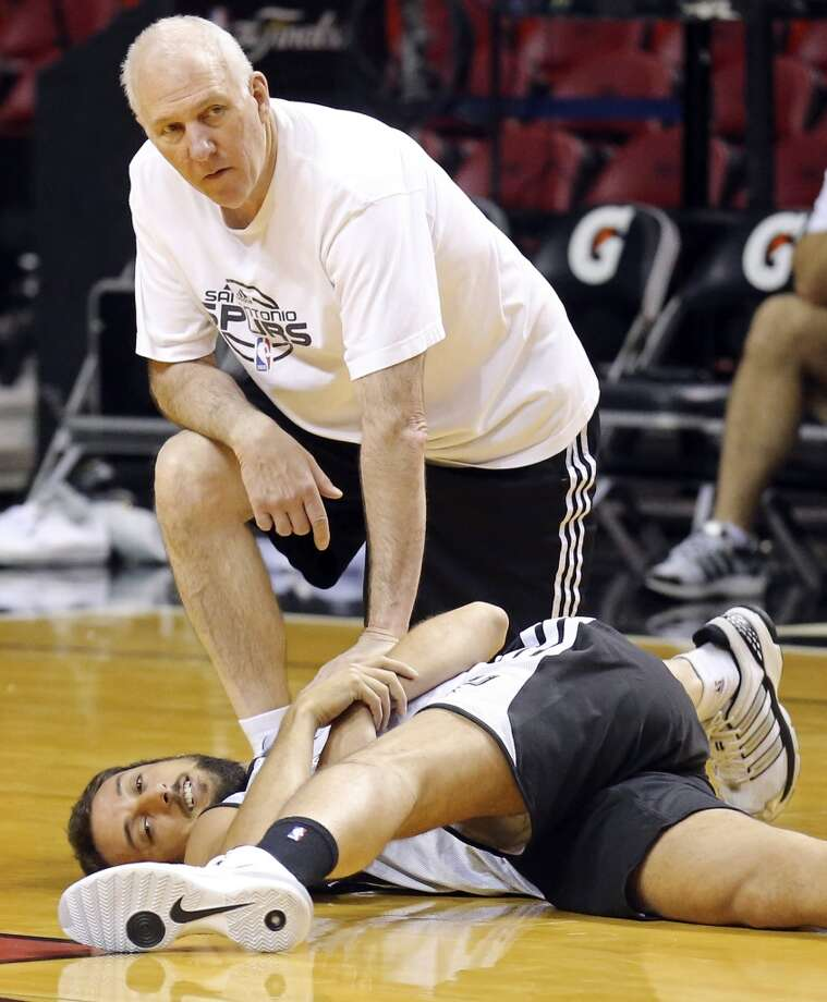 San Antonio Spurs head coach Gregg Popovich talks with Marco Belinelli during practice Wednesday June 11, 2014 at American Airlines Arena in Miami, Fla. Photo: San Antonio Express-News