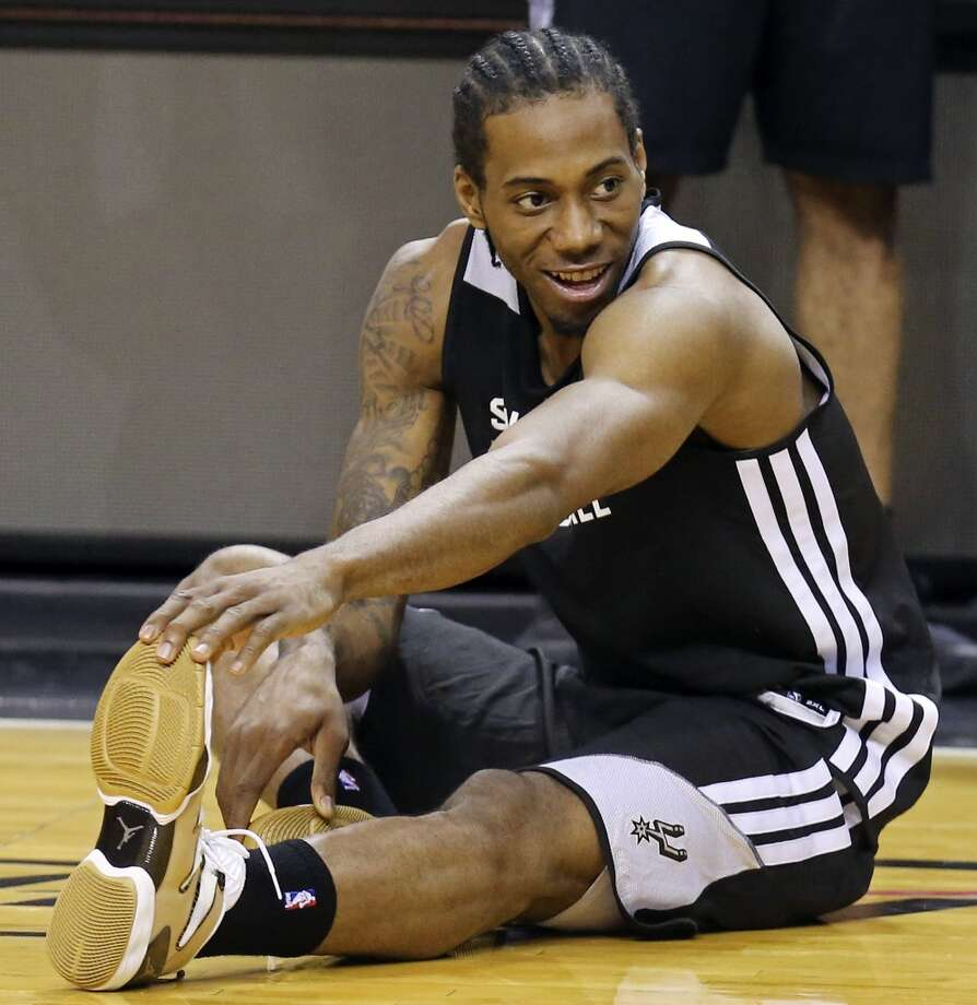 San Antonio Spurs' Kawhi Leonard stretches during practice Wednesday June 11, 2014 at American Airlines Arena in Miami, Fla. Photo: San Antonio Express-News