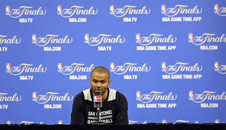 San Antonio Spurs' Tony Parker answers questions from the media Wednesday June 11, 2014 at American Airlines Arena in Miami, Fla. Photo: San Antonio Express-News