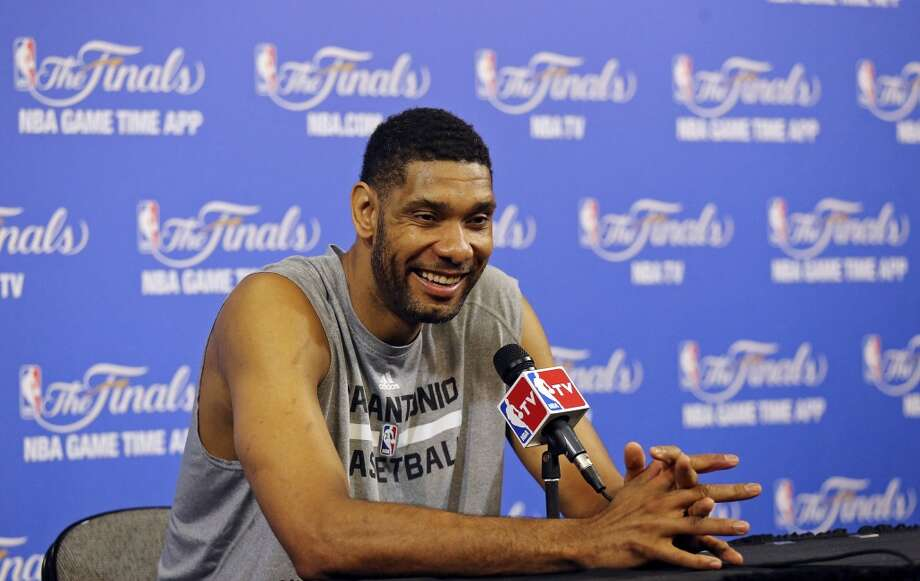 San Antonio Spurs' Tim Duncan answers questions from the media Wednesday June 11, 2014 at American Airlines Arena in Miami, Fla. Photo: San Antonio Express-News