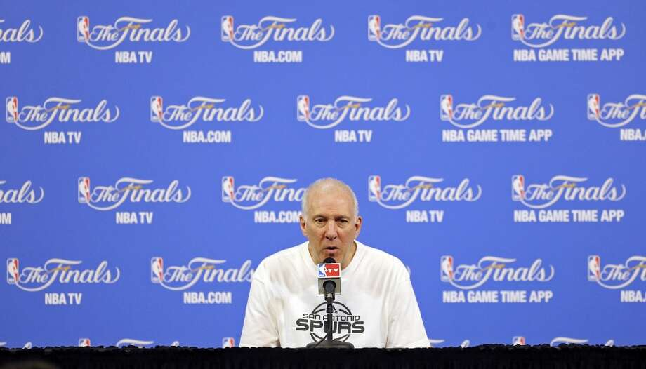 San Antonio Spurs head coach Gregg Popovich answers questions from the media Wednesday June 11, 2014 at American Airlines Arena in Miami, Fla. Photo: San Antonio Express-News
