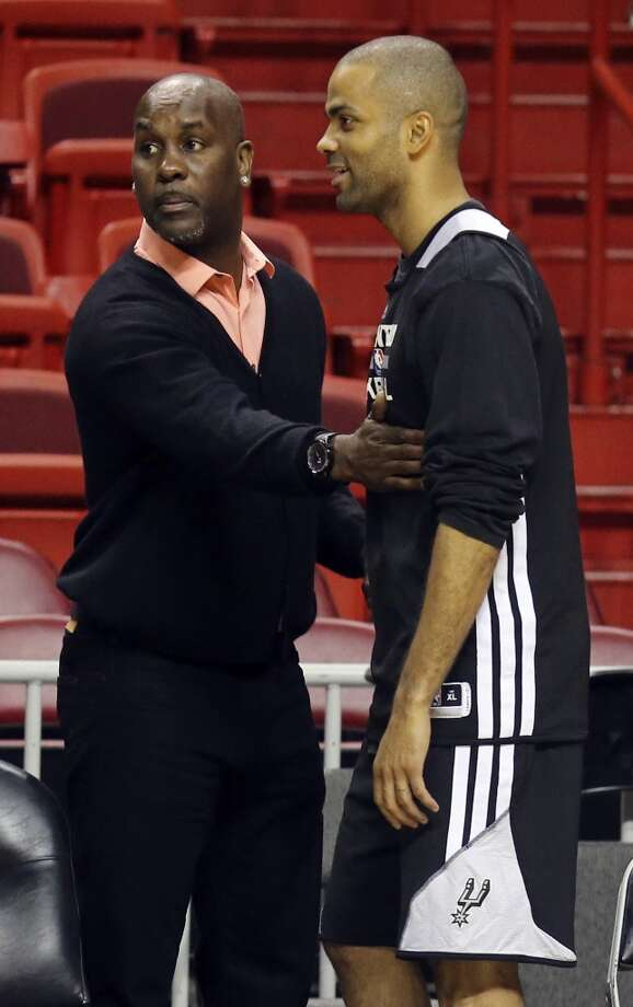 Former Seattle SuperSonics player Gary Payton (left) talks with San Antonio Spurs' Tony Parker during practice Wednesday June 11, 2014 at American Airlines Arena in Miami, Fla. Photo: San Antonio Express-News