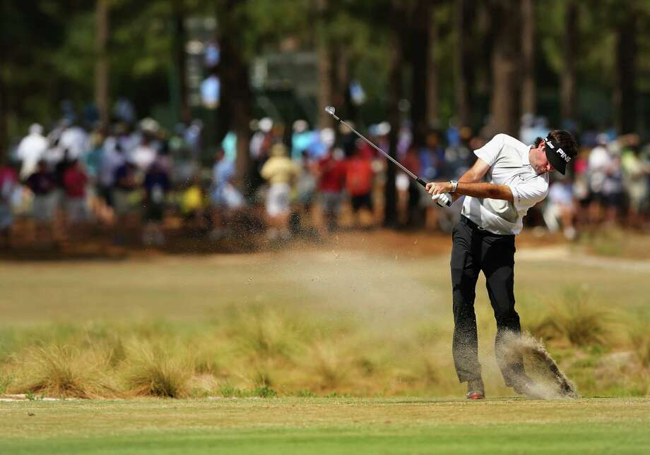 PINEHURST, NC - JUNE 11:  Bubba Watson of the United States hits an approach shot during a practice round prior to the start of the 114th U.S. Open at Pinehurst Resort & Country Club, Course No. 2 on June 11, 2014 in Pinehurst, North Carolina.  (Photo by Tyler Lecka/Getty Images) ORG XMIT: 461911121 Photo: Tyler Lecka / 2014 Getty Images