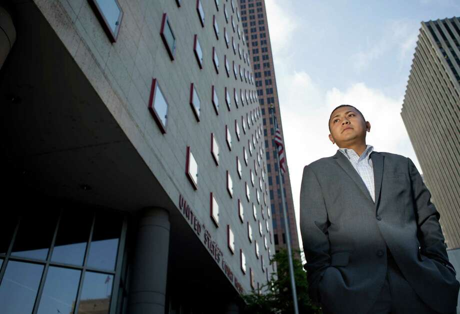 David Sanchez, 26, stands outside Houston's Federal Courthouse, where a judge will decide whether he was born in Texas and has a right to a U.S. passport. Photo: Cody Duty, Staff / © 2014 Houston Chronicle