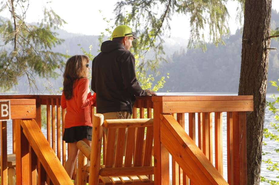 Denese Welch and Kevin Turner take in view from Cabin 5A Photo: Tom Stienstra