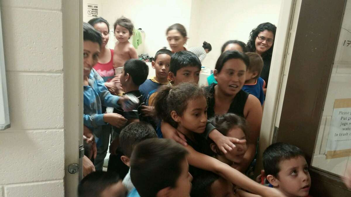 Immigrants crowd a detention facility after crossing the U.S.-Mexico border. Tens of thousands of immigrants were apprehended in the Valley in the first eight months of this fiscal year.