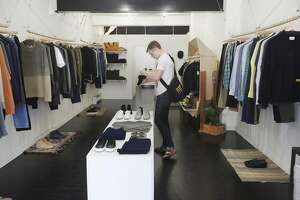 Andrew Coover, 23, looks at shoes June 7, 2014 in MAAS & Stacks menswear store in San Francisco, Calif.