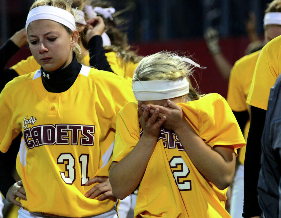 St. Joseph's Hanna Errico reacts as she and her fellow teammate Erica Fluskey, left, walk off the field after being defeated by East Haven, during Class M softball Semi-final action in Stratford, Conn. on Tuesday June 10, 2014. Photo: Christian Abraham / Connecticut Post