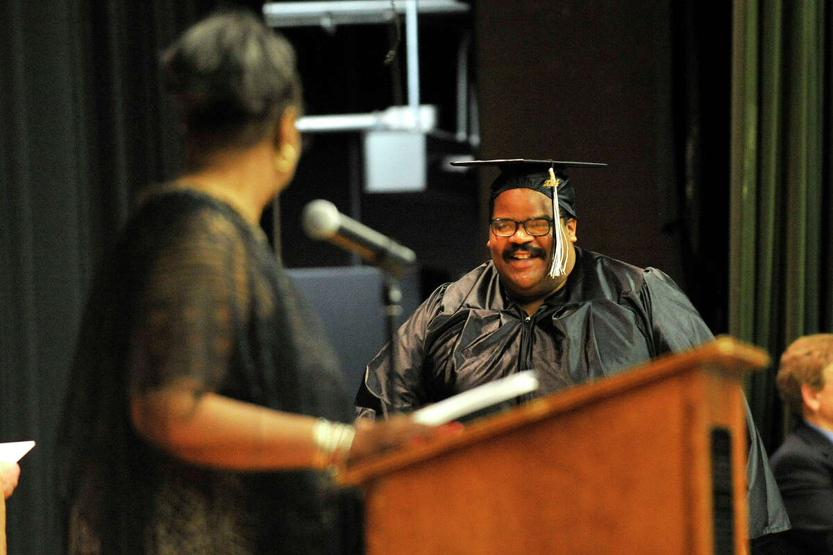 Jeffrey Burke crosses the stage to recieve his diploma during the Stamford Public Schools Adult and Continuing Education graduation at Cloonan Middle School in Stamford, Conn., on Wednesday, June 11, 2014.