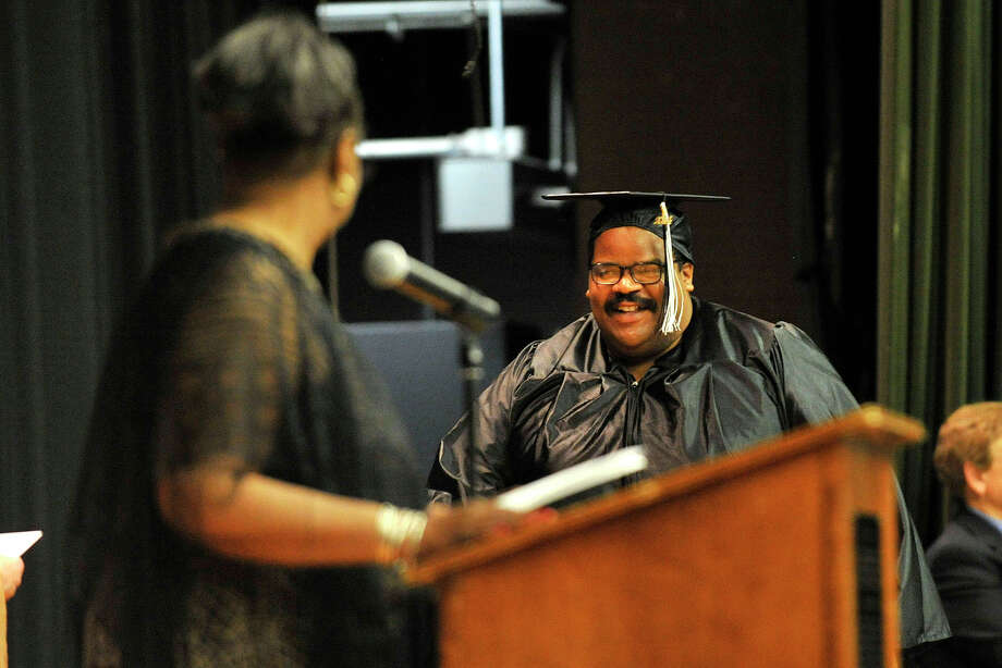 Jeffrey Burke crosses the stage to recieve his diploma during the Stamford Public Schools Adult and Continuing Education graduation at Cloonan Middle School in Stamford, Conn., on Wednesday, June 11, 2014. Photo: Jason Rearick / Stamford Advocate
