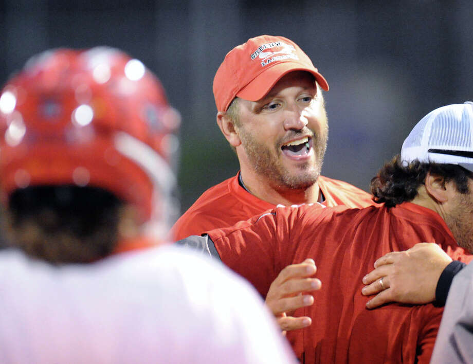 Greenwich High School boys lacrosse coach Scott Bulkley celebrates with his team at the end of the Class L boys lacrosse semifinal match against Ridgefield High School that Greenwich won, 7-5, at Brien McMahon High School in Norwalk, Wednesday night, June 11, 2014. Greenwich advanced to the championship match. Photo: Bob Luckey / Greenwich Time