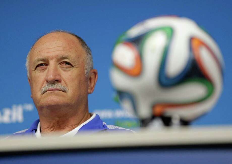 Brazil's coach Luiz Felipe Scolari attends a press conference the day before the group A World Cup soccer match between Brazil and Croatia at the Itaquerao Stadium in Sao Paulo, Brazil, on Wednesday, June 11, 2014. (AP Photo/Felipe Dana) Photo: Felipe Dana, STF / AP
