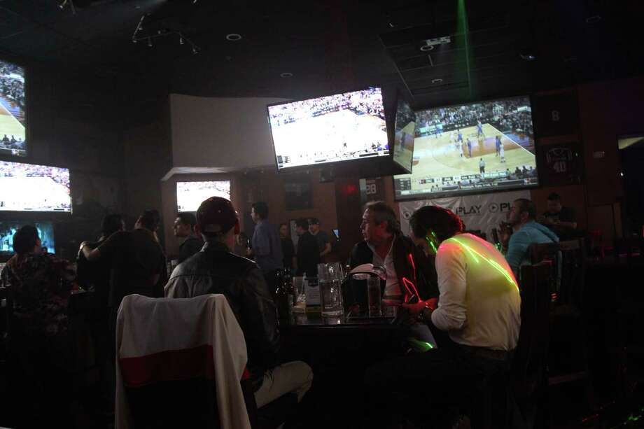 Play Sports + Kitchen, 18322 Sonterra Place Ste. 103 in San Antonio, 210-833-5370,www.playsportskitchen.comThe Stone Oak-area sports bar, which opened in August, feels almost packed with TVs and games. The framed jerseys on the wall include green-and-gold Pelé and blue-and white Maradona jerseys, a sign that the bar doesn't cater exclusively to Spurs fans. UFC fights and boxing matches tend to draw big crowds, as did a recent U.S.-Mexico soccer match. Photo: Xelina Flores-Chasnoff, San Antonio Express-News / For the Express News