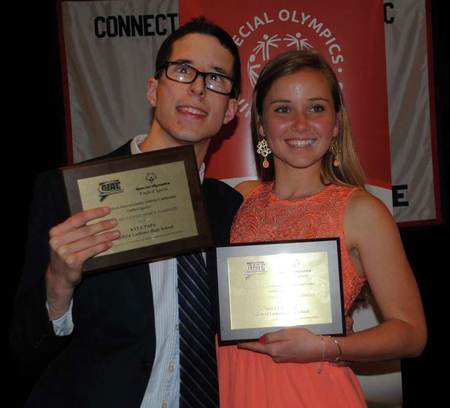 Kyle Papa-Stapleton, left, a Fairfield Ludlowe graduate, and Molly Roach, a Ludlowe senior, with their One Athlete One Partner award they received in late April for their exemplary involvement with the Special Olympics Unified Sports program. Photo: Contributed Photo / Fairfield Citizen