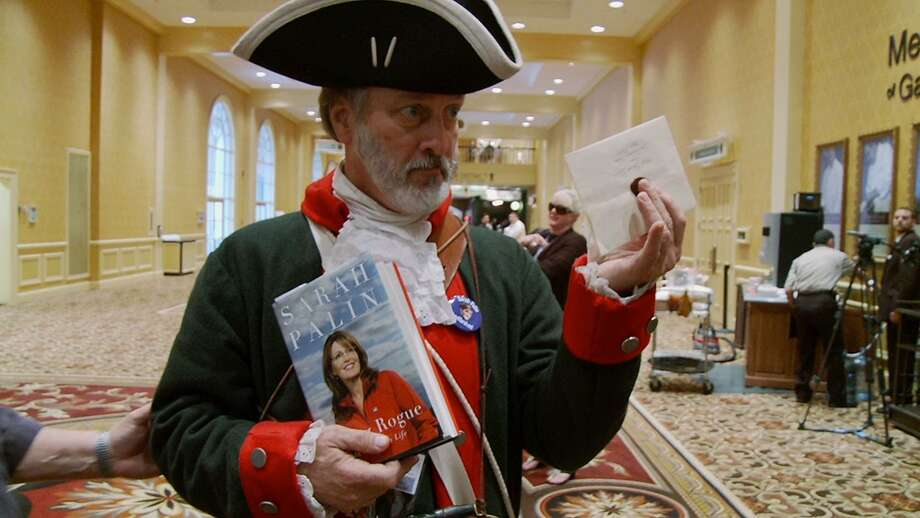 "A man tells ""Citizen Koch"" filmmakers Carl Deal and Tia Lessin he has claimed Sarah Palin as his woman and has an invitation for her. Photo: Variance Films"