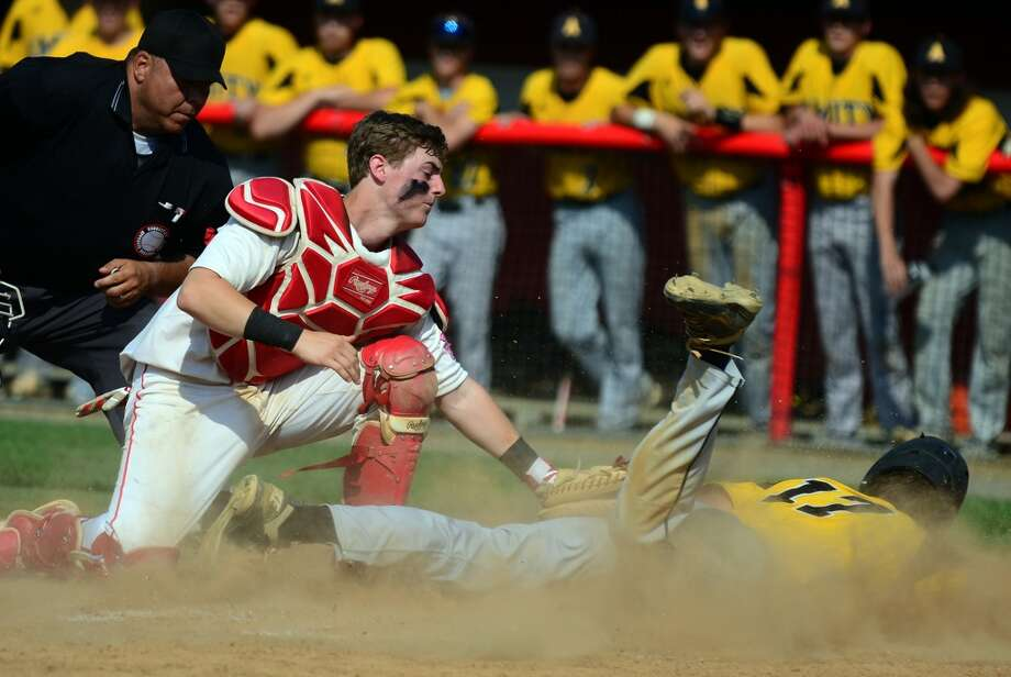 Fairfield Prep catcher Jake Berry tries to make the tag at home plate on Amity's Kevin Nusdeo, during Class LL State Baseball Tournament action at Fairfield University in Fairfield, Conn. on Tuesday June 3, 2014. Photo: Christian Abraham