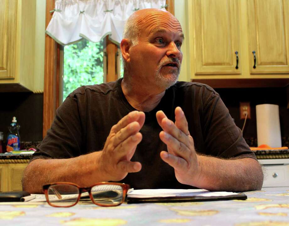 Jeff Arnow discusses his displeasure over a proposed plea deal Wednesday morning, June 11, 2014, during an interview at his home in Glenville, N.Y. Arnow is calling on a judge to reject a proposed plea deal related to a 2013 road rage episode against a Schenectady police detective. (Selby Smith / Special to the Times Union) Photo: Selby Smith / 00027317A
