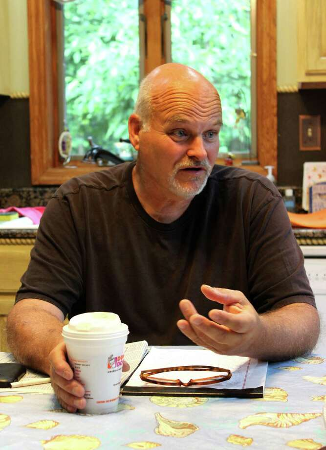 Jeff Arnow discusses his displeasure over a proposed court ruling Wednesday morning, June 11, 2014, during an interview at his home in Glenville, N.Y. Arnow is calling on a judge to reject a proposed plea deal related to a 2013 road rage episode against a Schenectady police detective. (Selby Smith / Special to the Times Union) Photo: Selby Smith / 00027317A