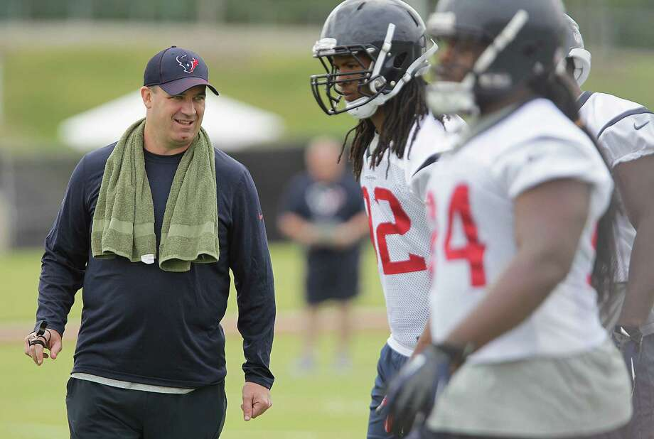 Bill O'Brien, left, will try to break up the monotony of training camp and get a different perspective on his team by scheduling practices with the Falcons and Broncos before preseason games. Photo: James Nielsen, Staff / © 2014  Houston Chronicle