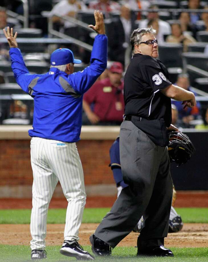 NEW YORK, NY - JUNE 11: Manger Terry Collins of the New York Mets is ejected from the game by home plate umpire Gary Cederstrom after Collins argued a disputed call at first base in the fifth inning during the game at Citi Field on June 11, 2014 in the Flushing neighborhood of the Queens borough of New York City. (Photo by Andy Marlin/Getty Images) ORG XMIT: 477584819 Photo: Andy Marlin / 2014 Getty Images