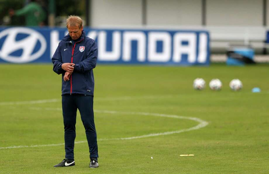 United States' head coach Juergen Klinsmann checks his watch before the start of a training session at the Sao Paulo FC training center in Sao Paulo, Brazil, Wednesday, June 11, 2014. The U.S. will play in group G of the 2014 soccer World Cup. (AP Photo/Julio Cortez) Photo: Julio Cortez, STF / AP