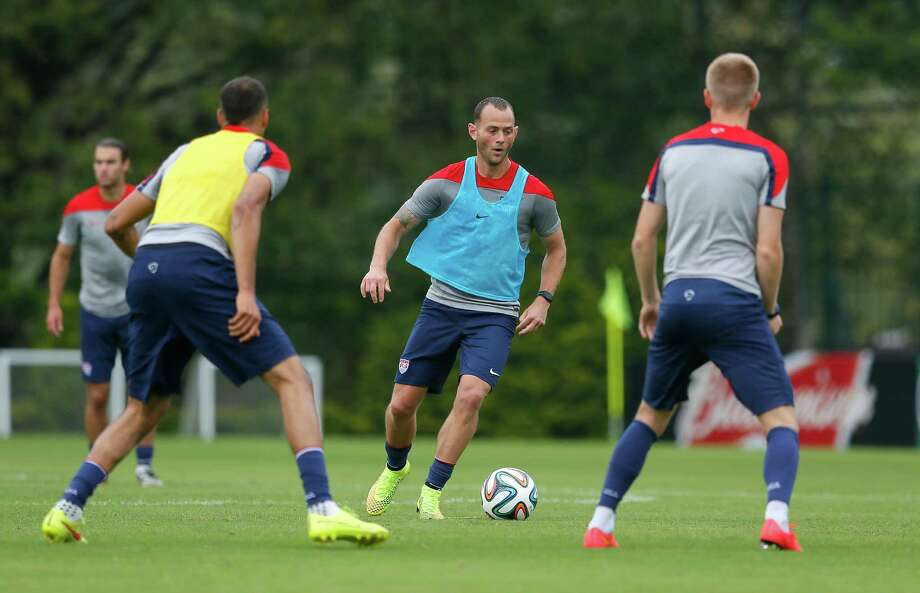 Dynamo midfielder Brad Davis, center, participates in drills during Wednesday's U.S. training session in Sao Paulo, Brazil. Photo: Kevin C. Cox, Staff / 2014 Getty Images