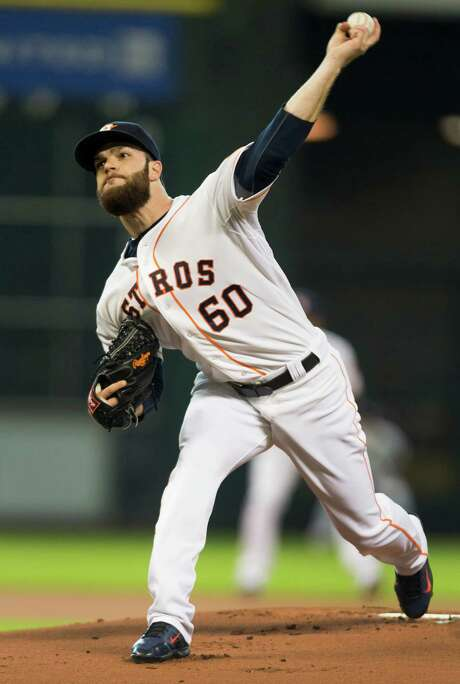 Dallas Keuchel was the picture of efficiency again, picking up his eighth win by holding the Diamondbacks to one run in eight innings. Photo: Brett Coomer, Staff / © 2014 Houston Chronicle