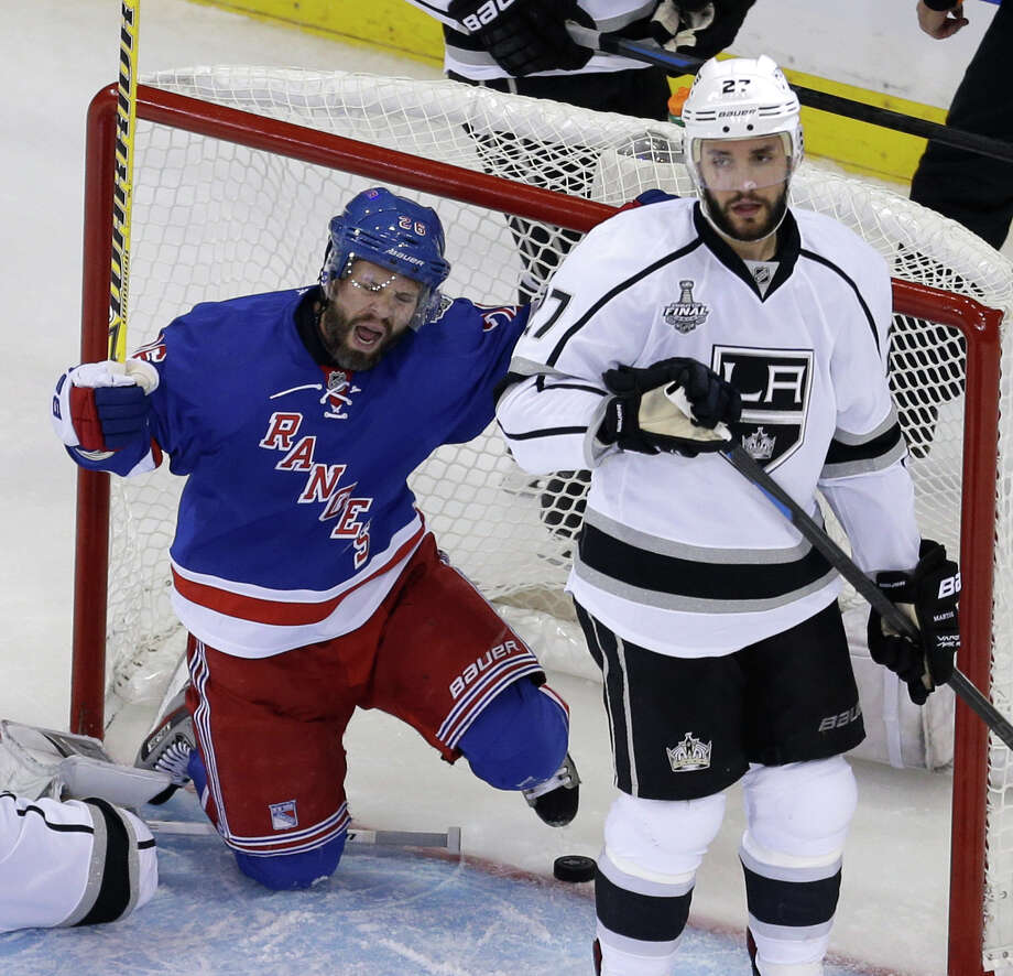 New York Rangers right wing Martin St. Louis (26), left, and Los Angeles Kings defenseman Alec Martinez (27) react after St. Louis scored in the second period during Game 4 of the NHL hockey Stanley Cup Final, Wednesday, June 11, 2014, in New York. (AP Photo/Seth Wenig) ORG XMIT: MSG210 Photo: Seth Wenig / AP