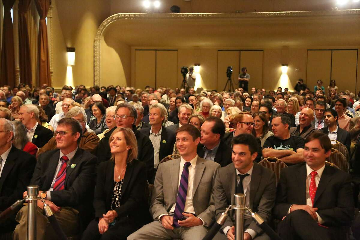 Audience members smile during Texas Gov. Rick Perry's speech at an event with the Commonwealth Club of California at the Intercontinental Mark Hopkins Hotel on Wednesday, June 11, 2014 in San Francisco, Calif.