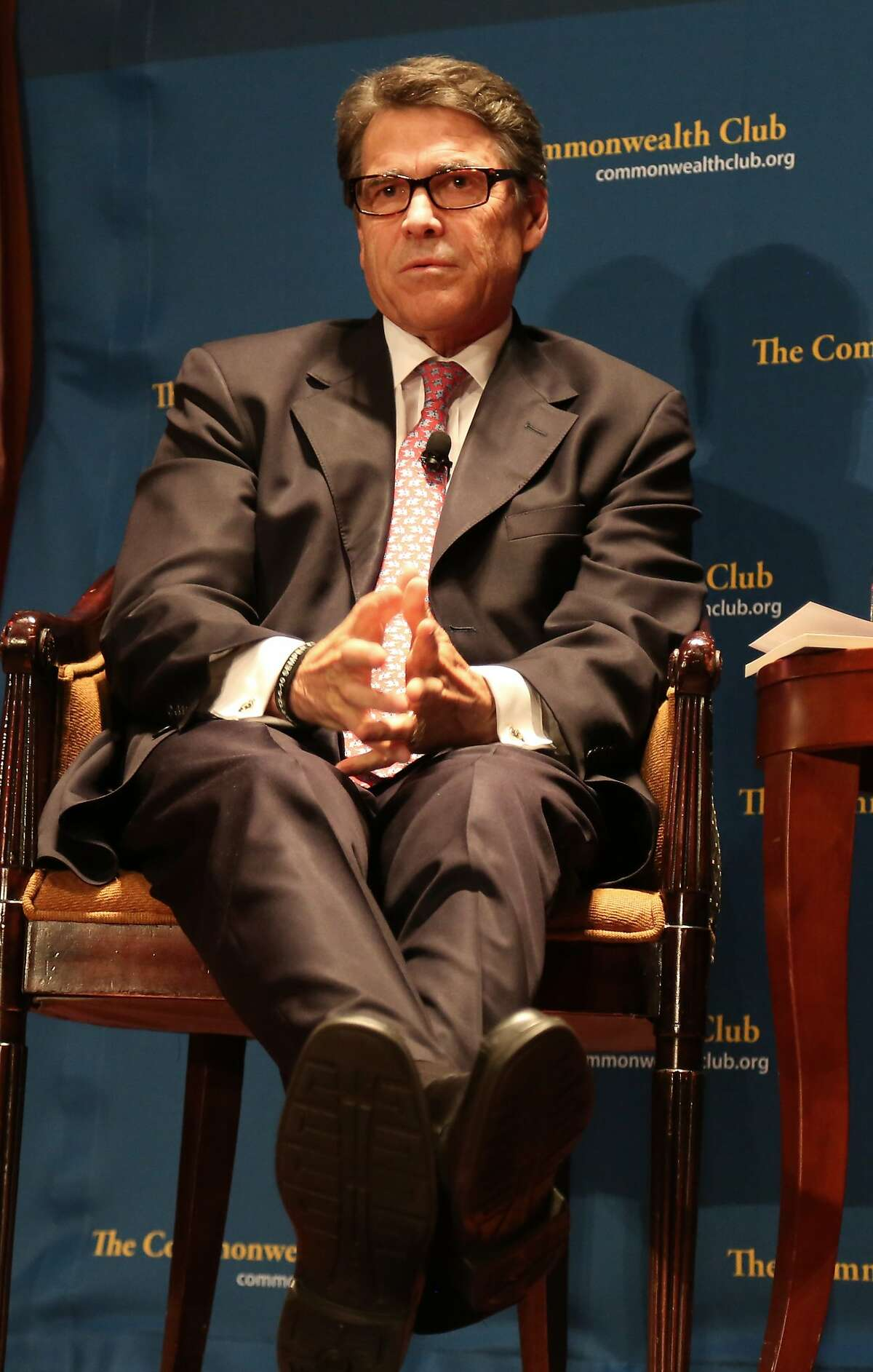 Texas Gov. Rick Perry relaxes during an event with the Commonwealth Club of California at the Intercontinental Mark Hopkins Hotel on Wednesday, June 11, 2014 in San Francisco, Calif.
