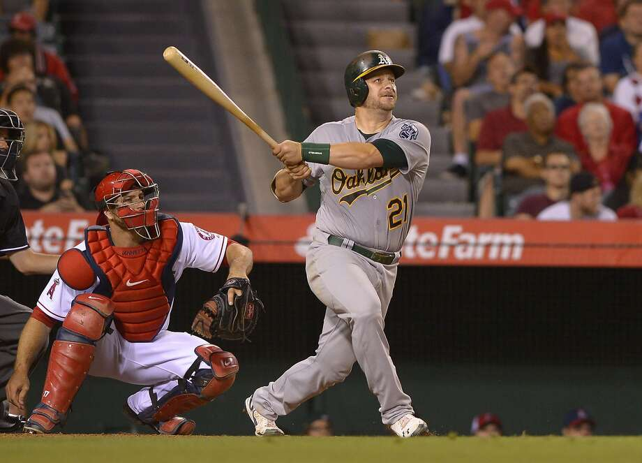 A's catcher Stephen Vogt hits his first homer of the season, a two-run shot off the Angels' Jered Weaver in the sixth inning. Photo: Mark J. Terrill, Associated Press