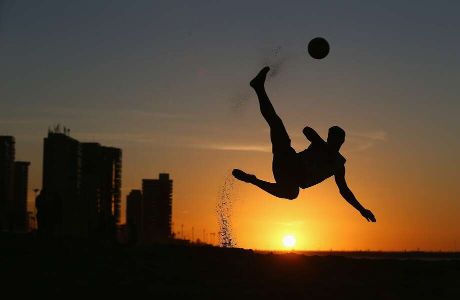 Scissors kick on the sand:A boy shows off his futbol skills on Magna Praia beach in Fortaleza, Brazil. Photo: Michael Steele, Getty Images
