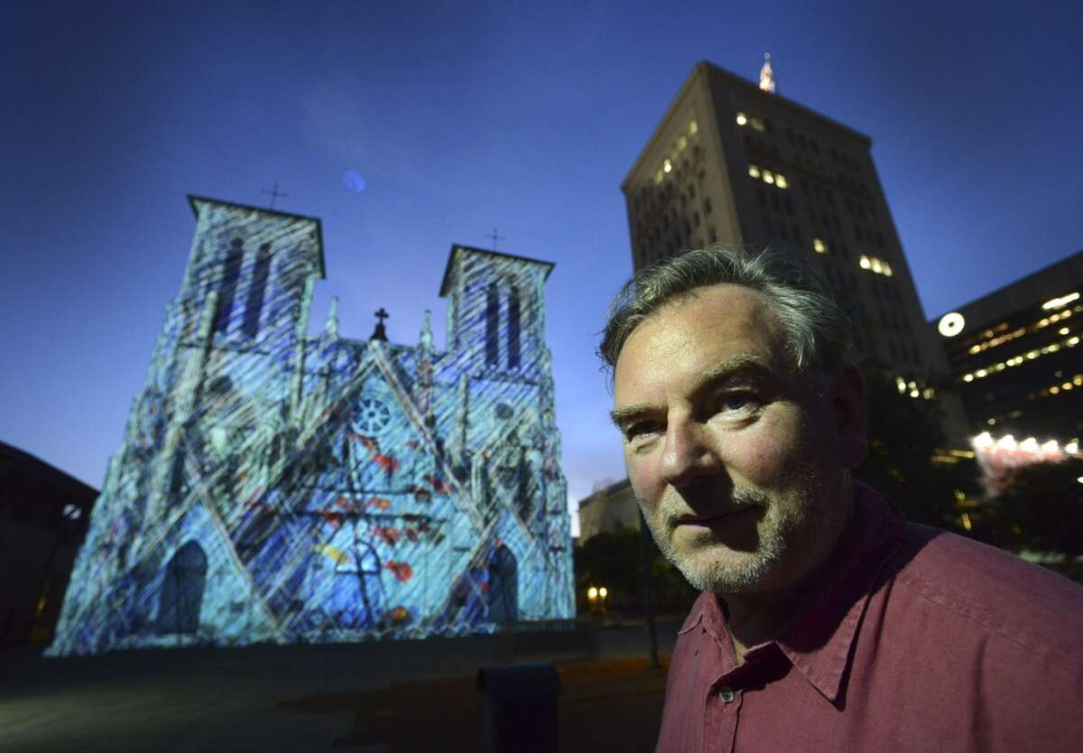 """French artist Xavier de Richemont stands before San Fernando Cathedral as his visual art, called """"San Antonio �"""